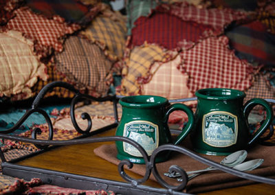 Lumberjack 2 cups on bed   Second Wind Country Inn, Ashland, WI