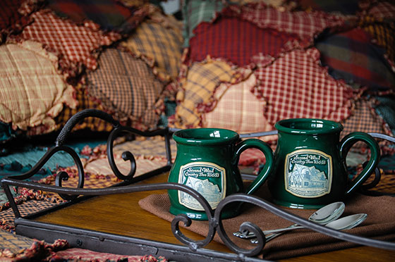 Lumberjack 2 cups on bed | Second Wind Country Inn, Ashland, WI