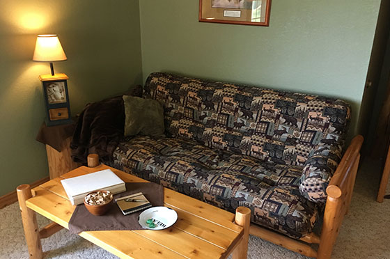 Pine Cone Hollow Sofa and Table | Second Wind Country Inn, Ashland, WI
